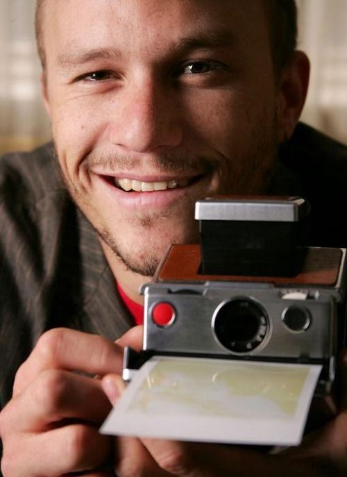 Мужчина с фотоаппаратом